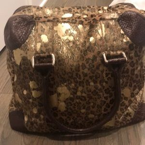 Handbags - Cowhide animal print with gold splashed of paint!